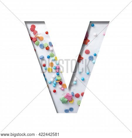 Sweet Glaze Font. The Letter V Cut Out Of Paper On The Background Of White Sweet Glaze With Colored