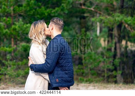 Happy Loving Couple Enjoying In Moments Of Happiness In The Park. Love Tenderness,dating, Romance. L
