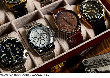 2021-06-02 Various Collection Of Homage Wrist Watches In The Watches Box On The Wood Table In Bangko