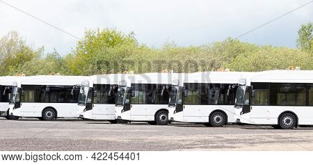 Long White Busses, Large Capacity Public Transport