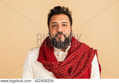 Indian man wearing a kurta with a red scarf