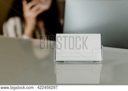 Receptionist sitting by the company name card