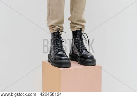 Standing woman wearing combat boots