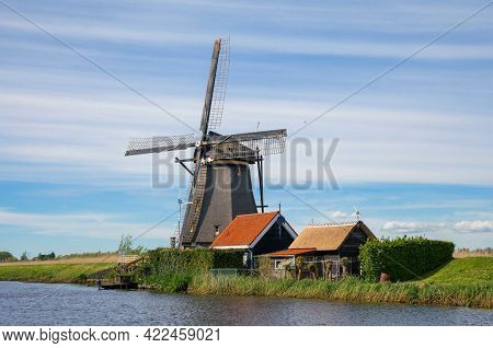 Traditional Dutch Windmills On The Canal. Outdoor Scene In Famous Dutch Village Kinderdijk, Holland