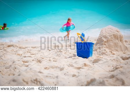 Kids Toys And Little Girl Play With Water On Beach