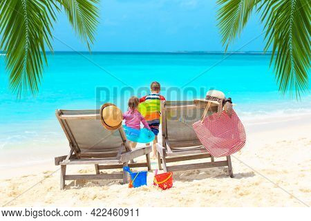 Happy Family On Luxury Tropical Beach Vacation