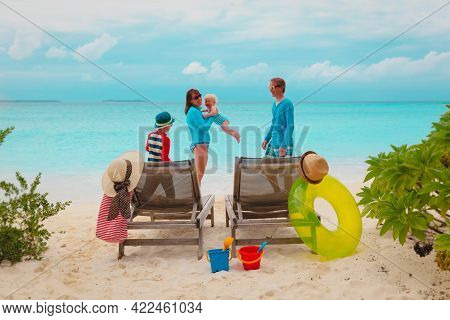Happy Family With Kids On Beach Vacation