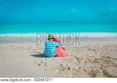 Happy Boy And Girl Hug On Beach Vacation