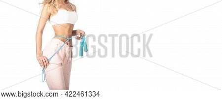 Fit Fitness Girl Measuring Her Waistline With Measure Tape. Slim Body, Jump Rope. Girl With Perfect