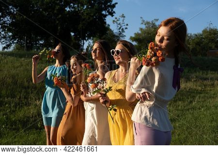 Group Of Happy Young Women, Female Friends Having Fun On Summer Nature Background. Many Young Female