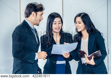 Business People In Group Meeting Working In Office Room With Colleagues. Corporate Workplace Concept