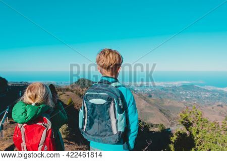Boy And Girl Travel In Mountains, Family Hiking In Nature
