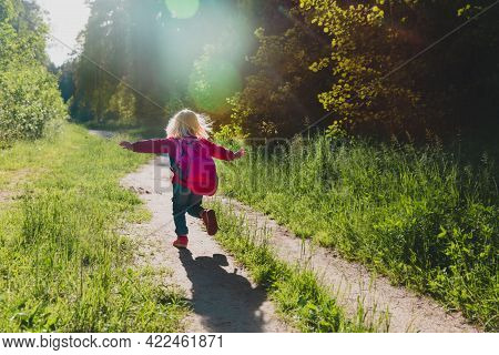 Silhouette Of Happy Little Girl Running In Sunset Nature