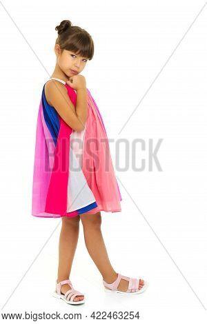 Beautiful Girl In Fluttering Sundress. Lovely Girl Posing In Studio On Isolated White Background. Fu