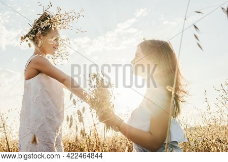 Young Mother And Daughter In Field Blurred.