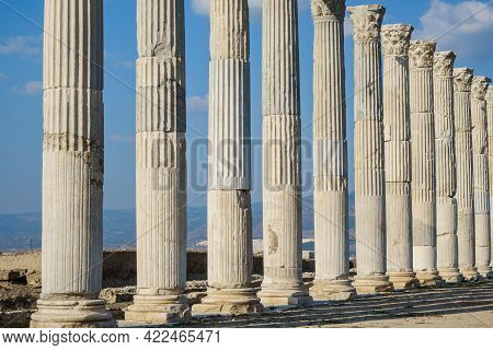 Perspective View Onto Antique Colonnade. All Columns Made In Corinthian Order. Shot In Ancient City