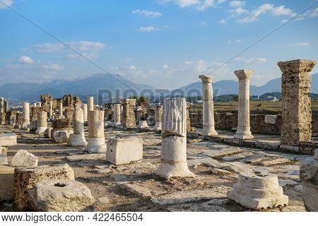 Side View Onto Empty Colonnaded Street In Antique City Laodicea, Near Denizli, Turkey. City Included