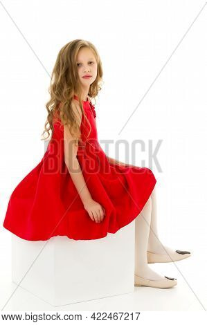 Portrait Of Lovely Blonde Girl In Nice Red Dress Posing In Front Of Camera In Studio, Charming Long