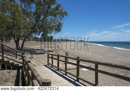 Wooden Walkway To Go Down To The Lonely Beach Of The Town Of Bolnuevo, In Mazarron, Murcia, Spain