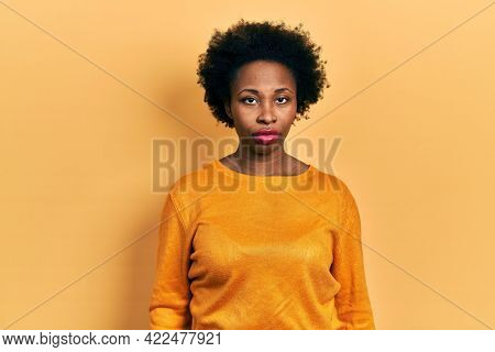 Young african american woman wearing casual clothes looking sleepy and tired, exhausted for fatigue and hangover, lazy eyes in the morning.