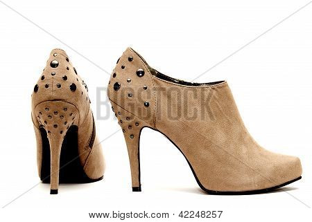 Womens Studded High Heels isolated on White Background poster