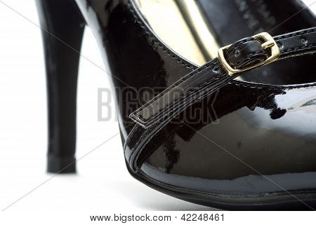 black female shoes on a white background