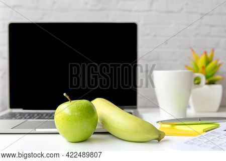 Healthy Snack With Working In Office.  Green Apple And Banana With Fresh Water For Diet Health Plann