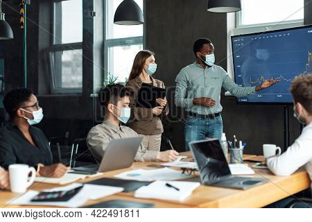 Colleagues Having Meeting In Boardroom, Black Businessman Giving Speech