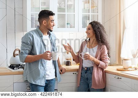 Home Leisure. Cheerful Middle Eastern Couple Spending Time In Kitchen Together