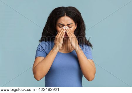 Young Black Woman Touching Her Nose Bridge, Suffering From Rhinitis, Grey Background