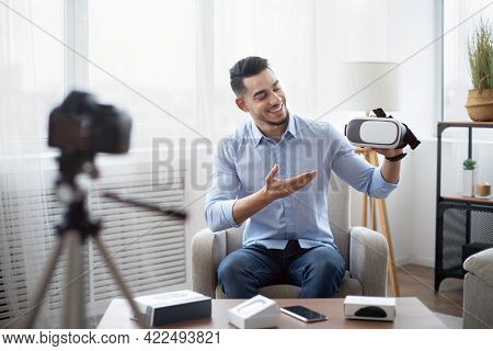 Tech Product Review. Male Vlogger Presenting Vr Headset, Recording Video About Innovative Device For