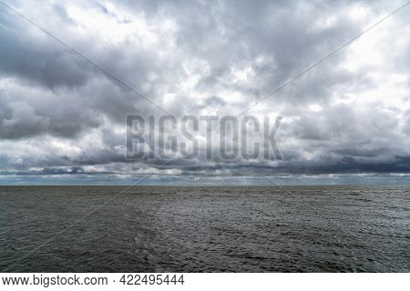 Landscape Of Expressive Cloudy And Overcast Sky Over A Windbeaten Wadden Sea In The Netherlands