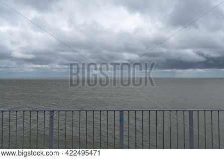 Landscape Of Expressive Cloudy And Overcast Sky Over A Windbeaten Wadden Sea In The Netherlands With
