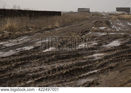 Dirt Road After Rain With Deep Tire Tracks