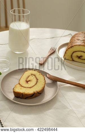 Sweets Soft Roll Cake With Milk On White Background.
