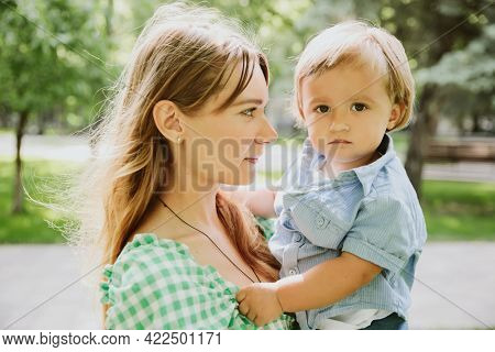 Young mother and little son