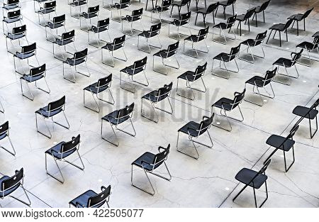 Many Black Chairs Standing Indoors At The Same Distance Before The Event, Pattern, Abstract Backgrou