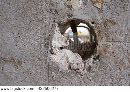 Repairing The Wall - Man Putting Spackle On A Hole In The Wall
