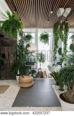 Concept Of Urban Jungle Interior. Vertical Shot Of Cozy Fully Furnished Bathroom Decorated With Gree