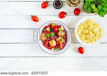 Traditional Italian Salad Tuscan Panzanella With Tomato, Bread And Pickled Olives