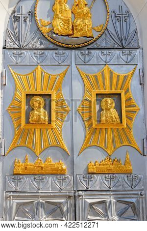 Close-up Of Entrance Door Decorated With Gilded Icons In Trinity Cathedral Of Holy Trinity-saint Ser