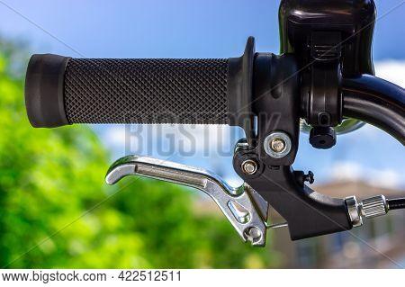 Bicycle Handlebars Against The Sky. Black Bicycle Handle. Bicycle Brake Handle.
