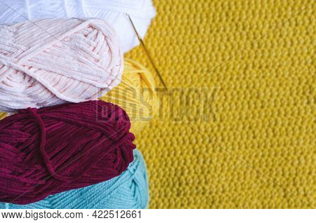 Skeins Of Colored Yarn And Knitting On A Dark Wooden Background Needlework On A Background Of Self-i