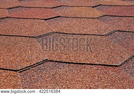 Protective Covering Of The Roof With Bitumen Shingles Of Hexagonal Shape Close-up Texture Of The Roo