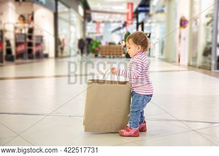 Black Friday Sale Concept, Shopping With Children, Nature Friendly Shopping. Little Cute Baby Girl P