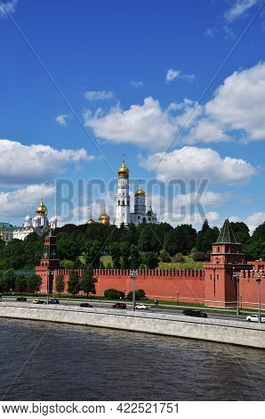 Moscow Kremlin. View Of The Towers And Churches Of The Kremlin. River And Embankment With Cars. Mosc
