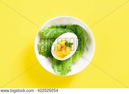 Deviled Egg With Paprika, Mustard And Mayonnaise On Vegetable Leaves. Appettizer For Breakfast Or Lu