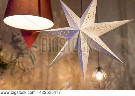 Beautiful Paper Lanterns In Shape Of Stars As Christmas Decorative Elements Lightning In Living Room