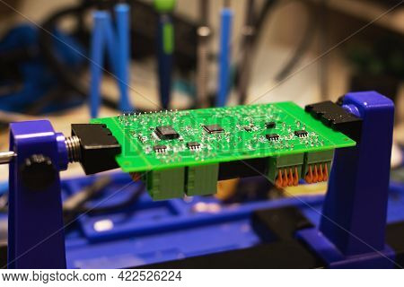 Soldering Process On A Green Pcb Closeup