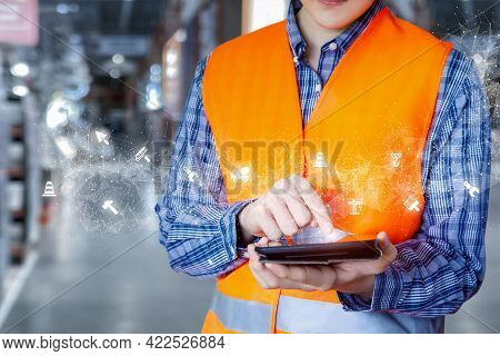 Builder Working With Construction Planning Software On A Mobile Device.